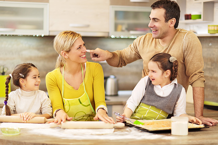 Happy family baking together.